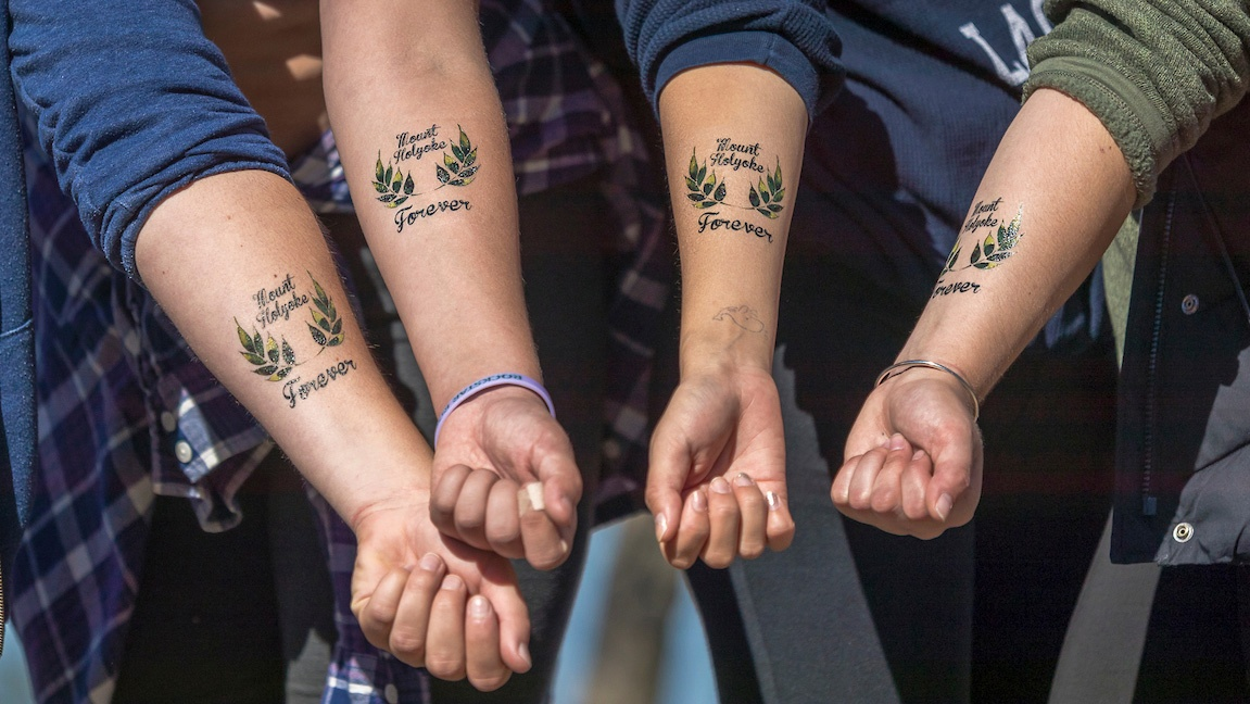 Students on Mountain Day sporting MHC tattoos
