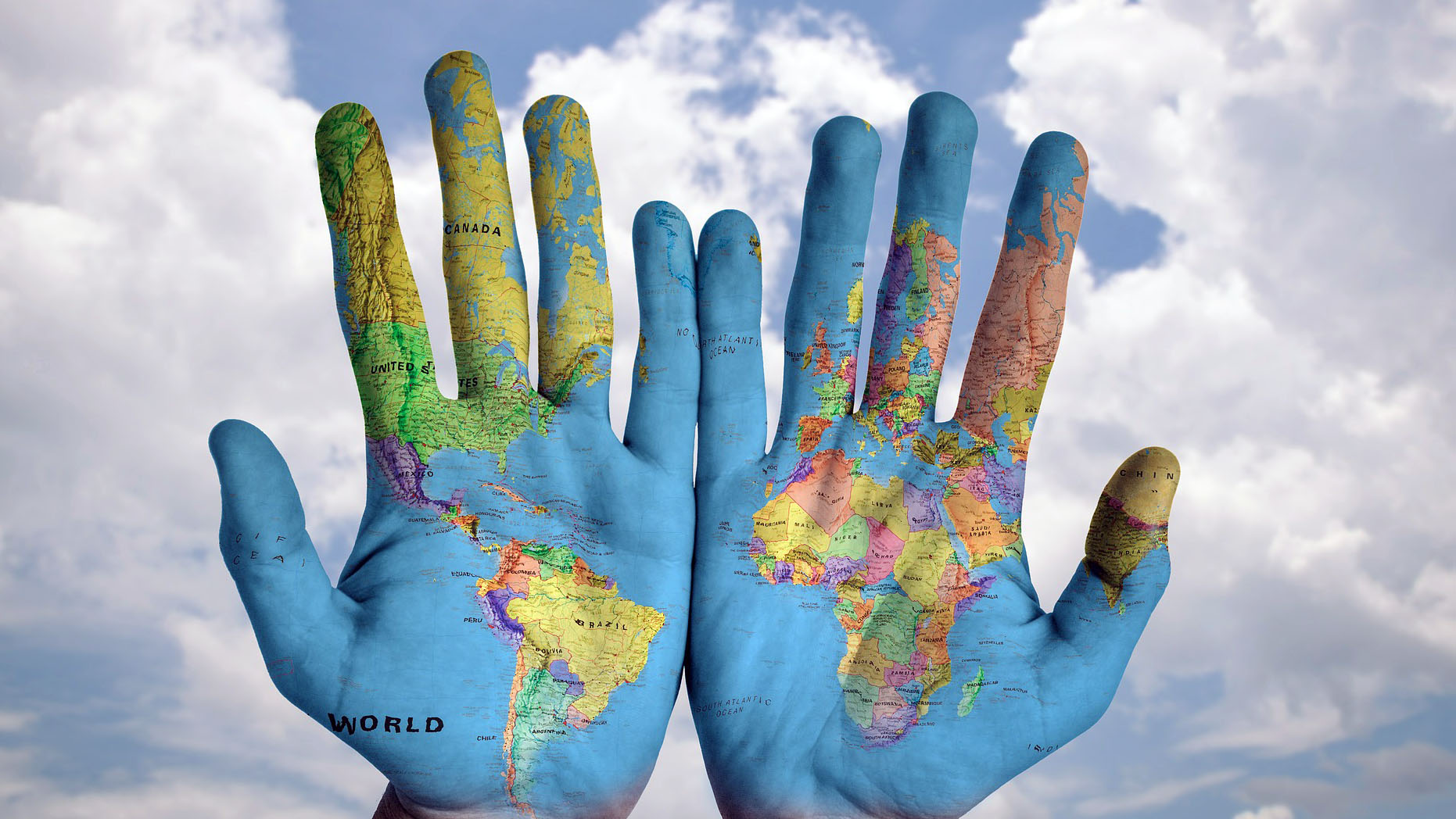 Open hands painted with globe