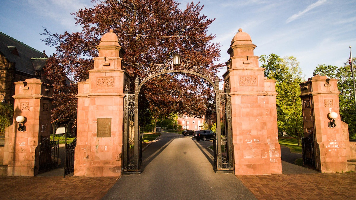 A bright view of the Fidelia Nash Field Gate, the gateway to Mount Holyoke, which was built in 1912.
