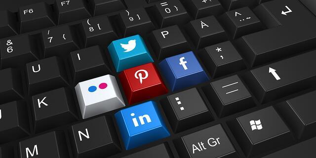 Close-up of a keyboard with social media icons as keys