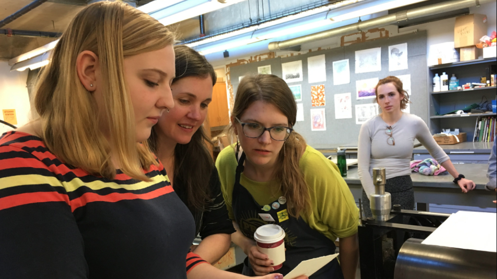 Tori Gernert-Dott '20 (left) examines a print with Andrews and Maciuba while Rebecca Grossman '18 looks on.