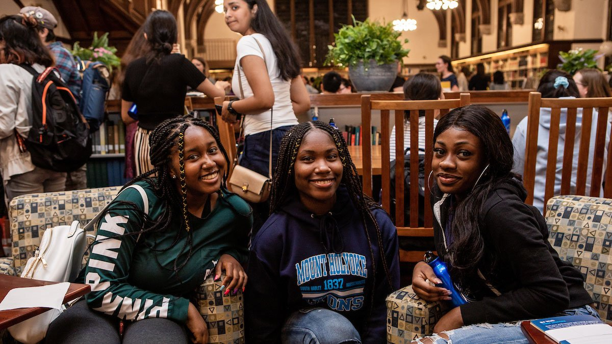 Students attend their first M&Cs, held in the library's main reading room during Orientation