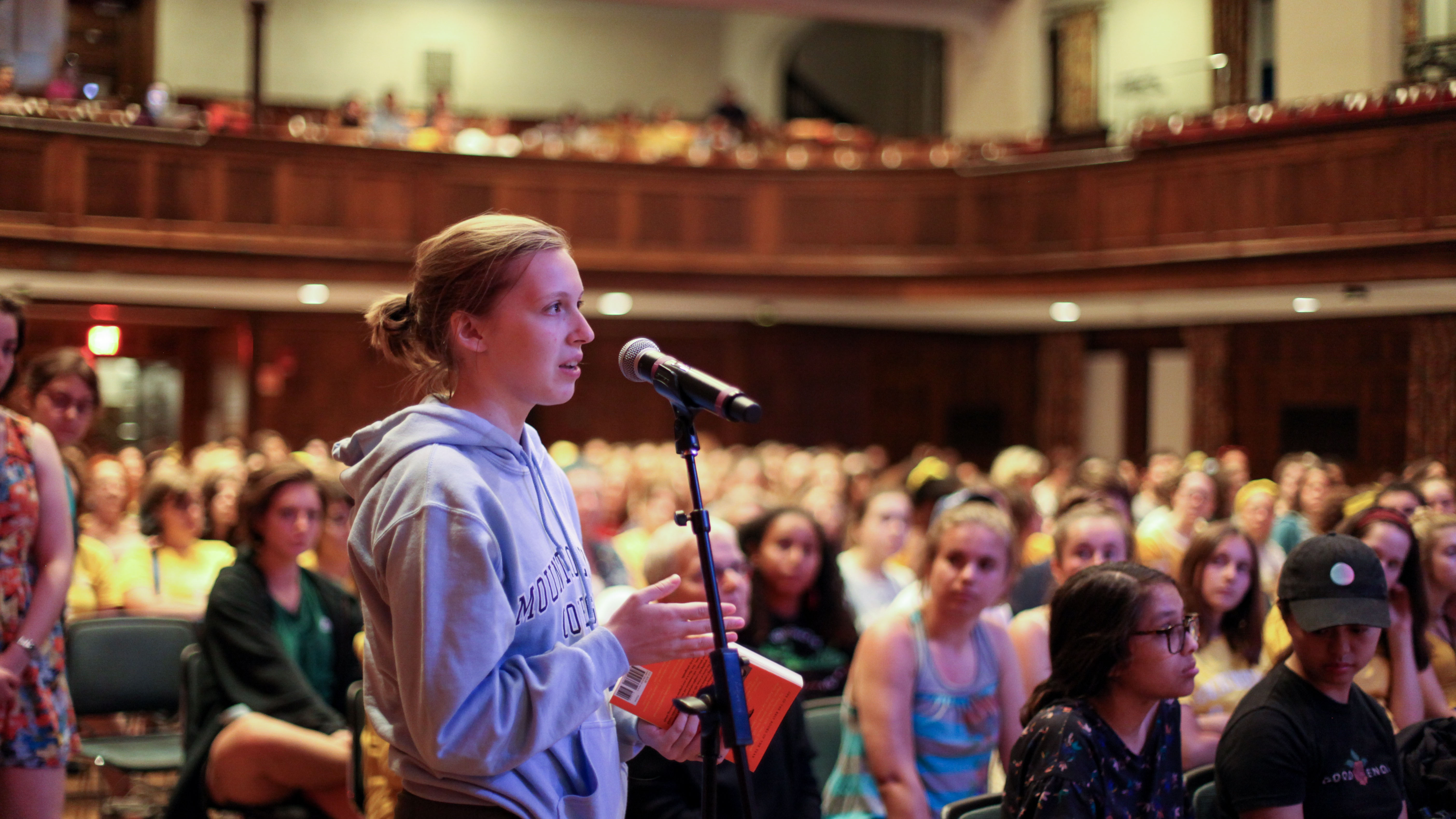 A student poses a question during the 2019 Common Read talk