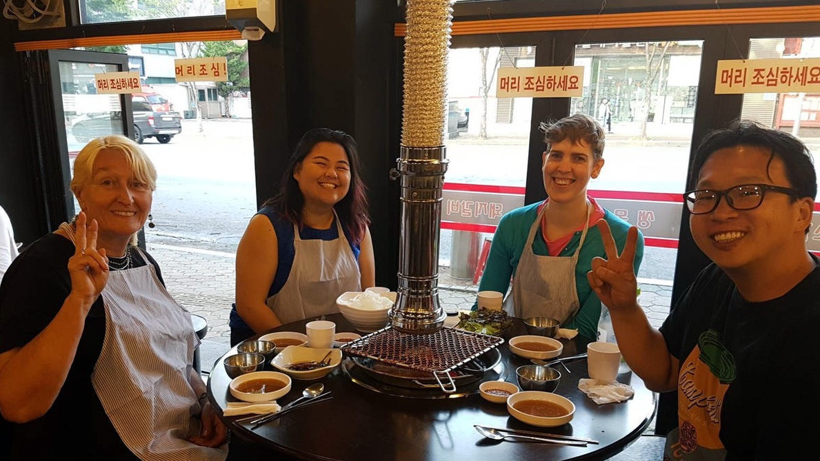 Camille Gladieux '18 (second from left) on a food tour guide trip