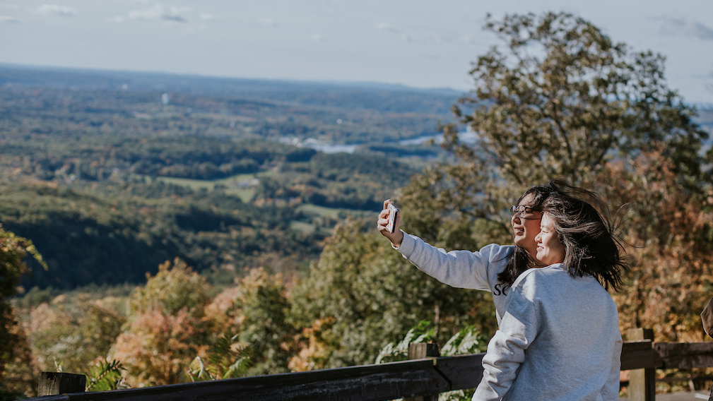 Students atop Mount Holyoke on Mountain Day 2018