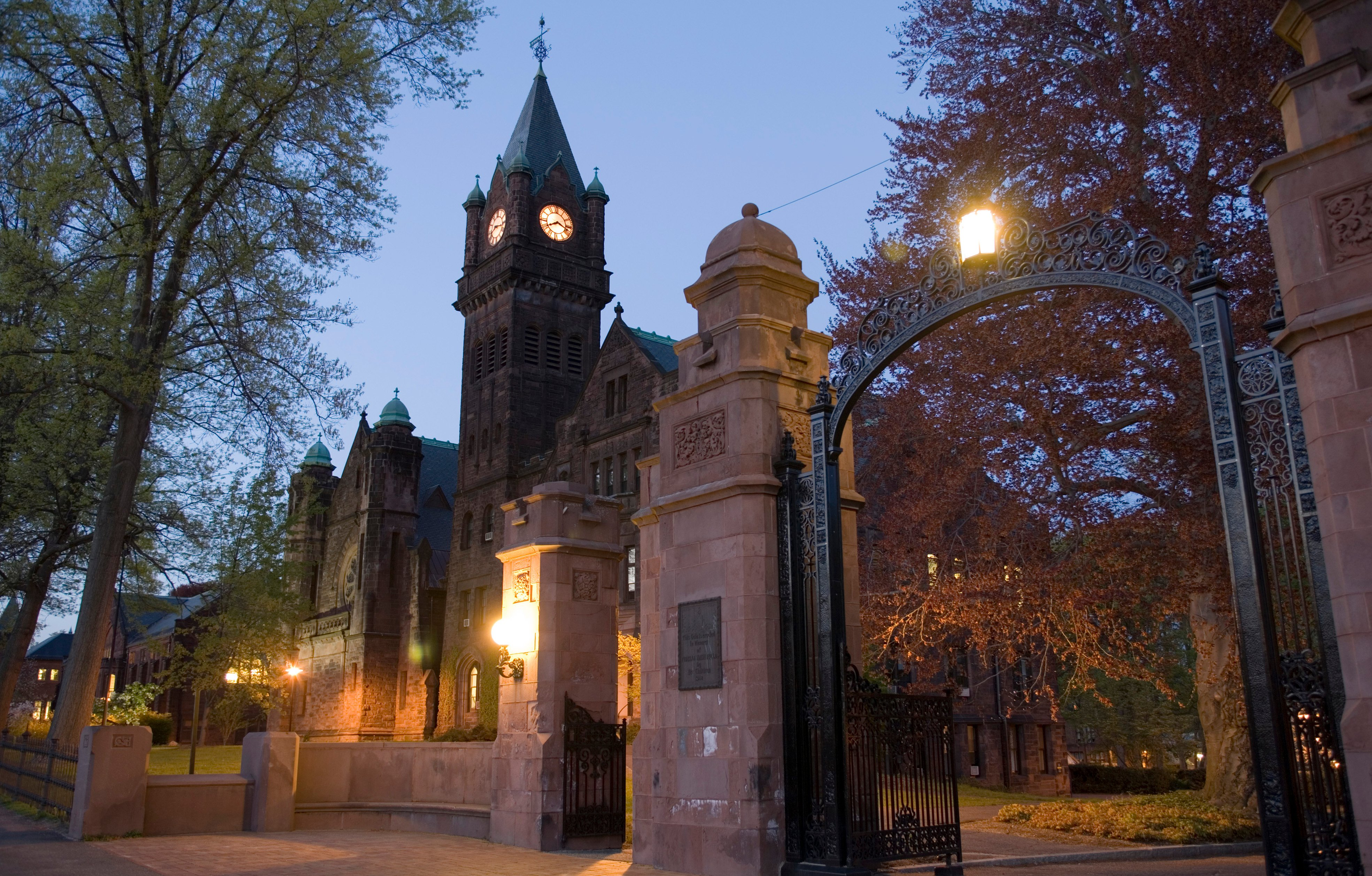 Mary Lyon Hall and the College gates at night