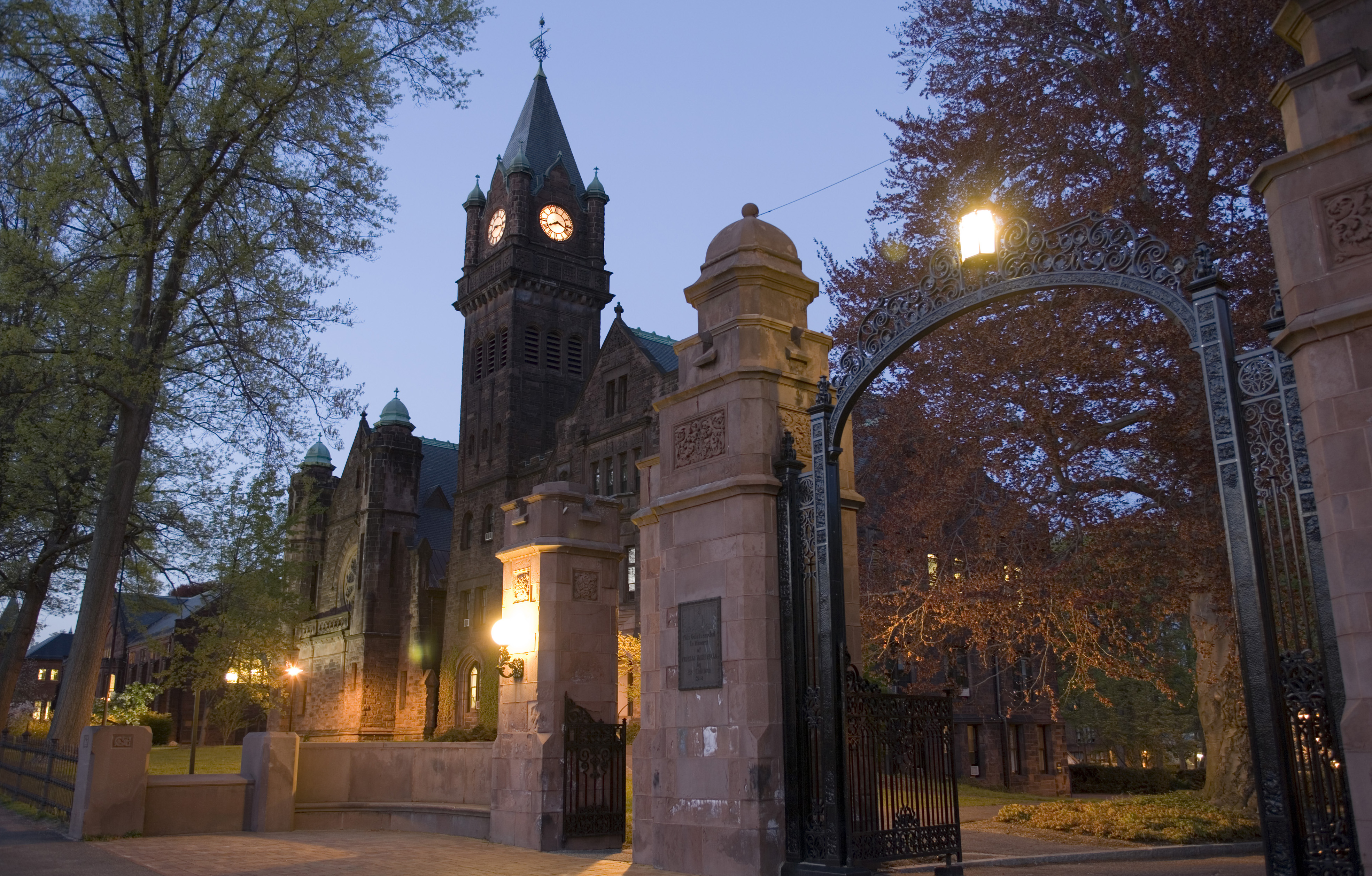 Mary Lyon Hall and the College gates at dusk
