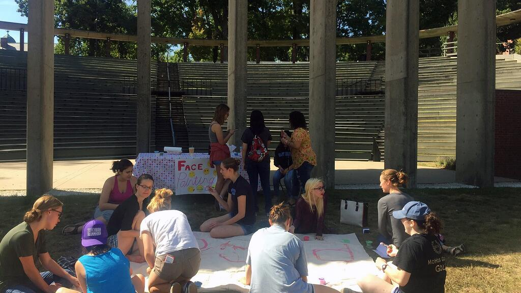 Bigs and Littles hanging out by the amphitheater