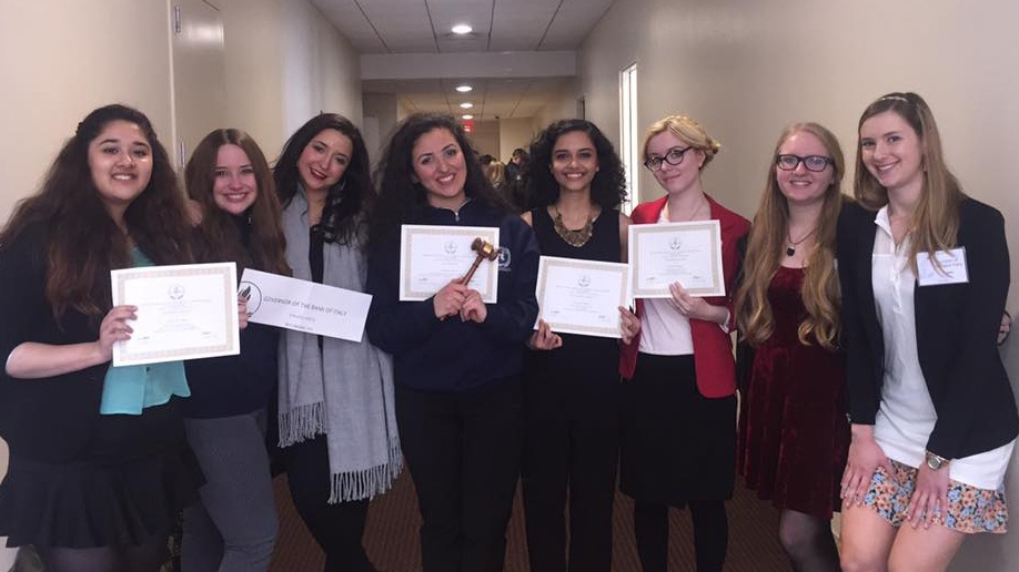 Marwa Mikati and Model UN team holding awards at NYU Model UN conference, April 2016