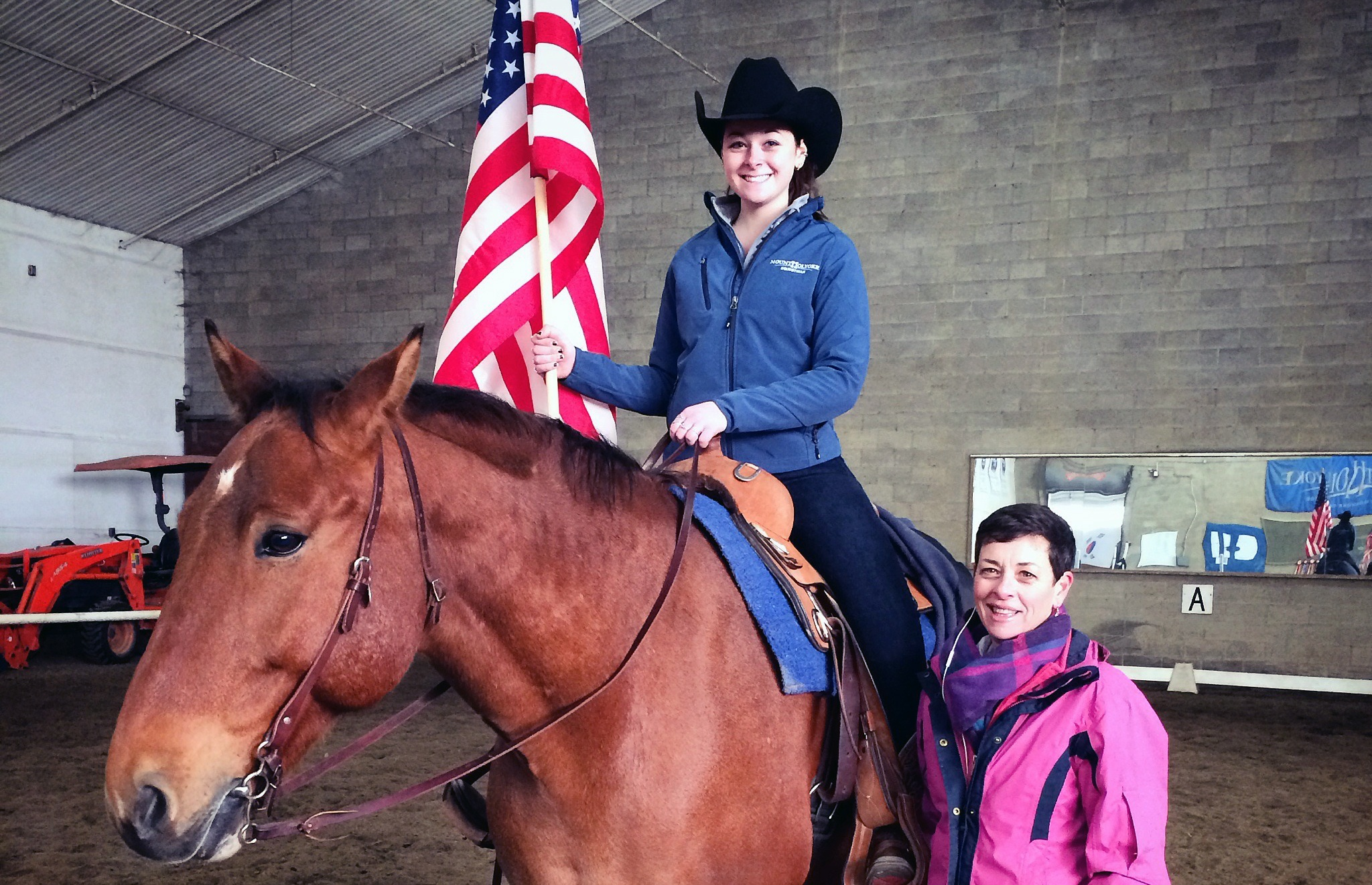 Victor, the star of the national anthemSabrina Fox '18, shown with her mother Anne Fox, rides Viktor during the national anthem.
