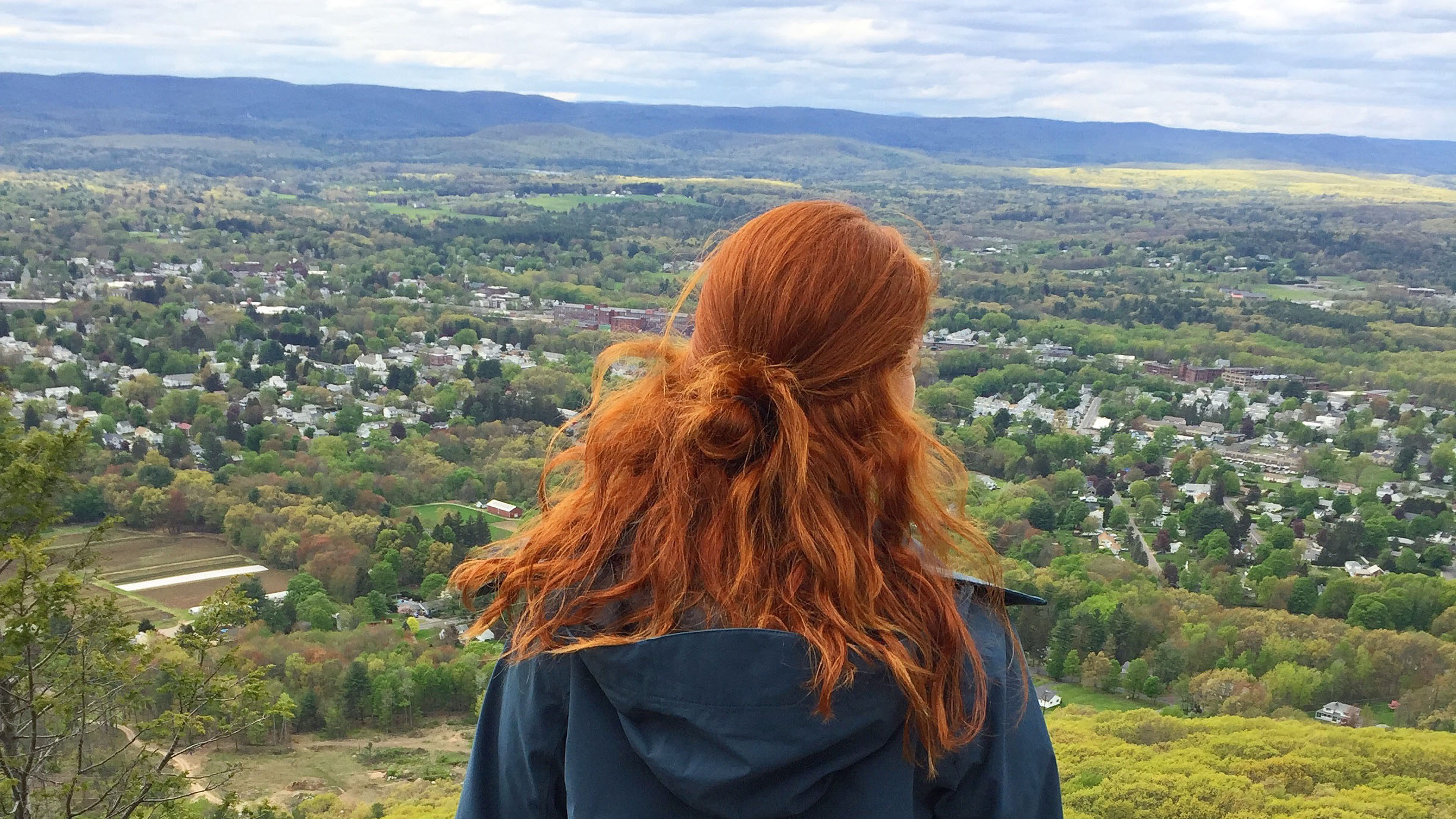 Maddy Skrak takes in the valley atop the summit of nearby Mount Tom