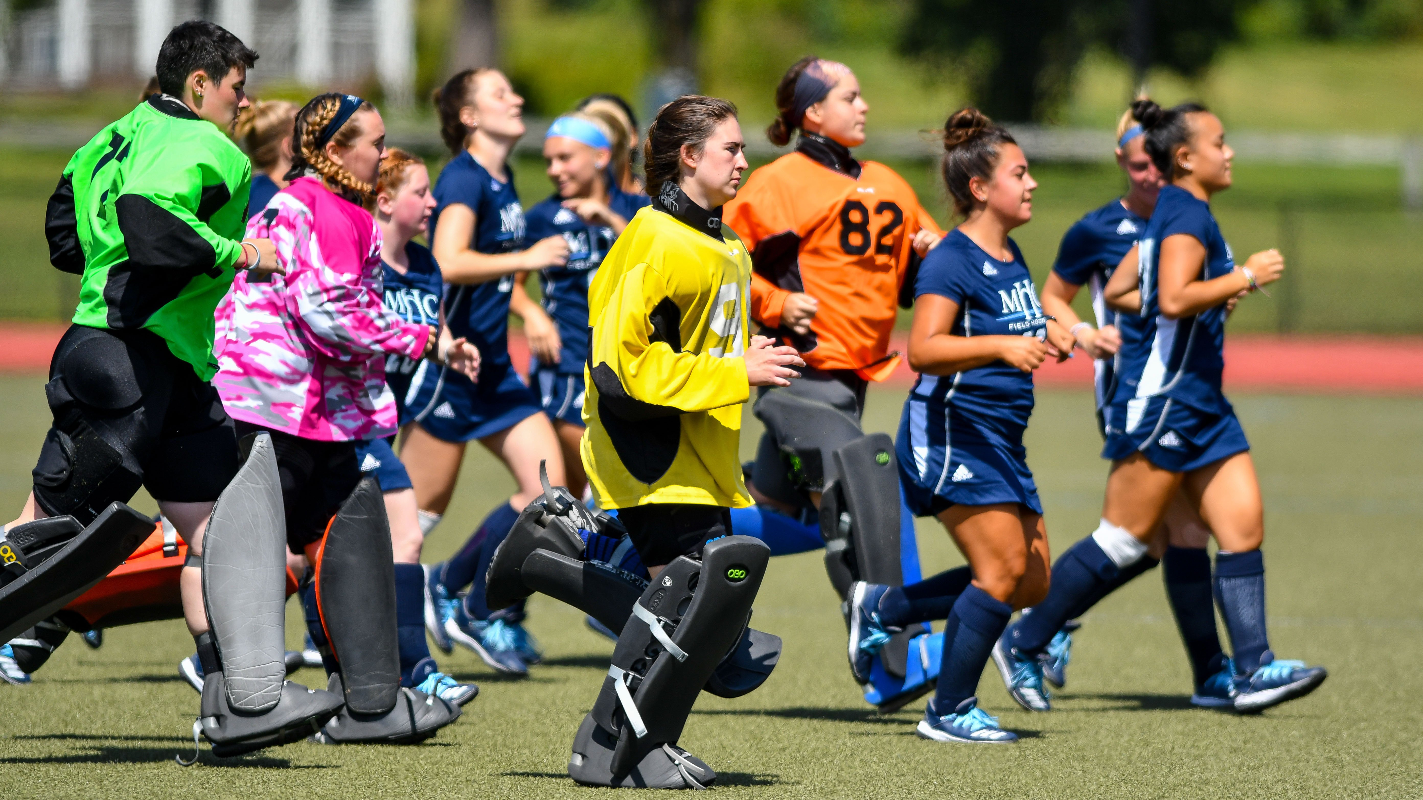 Author Morgan Turner '20 (#82) on the field with her teammates. Image courtesy of Mount Holyoke College Athletics.