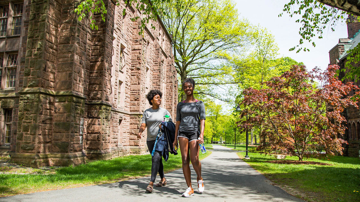 Donari Yahzid (right) and friend walk a path through campus