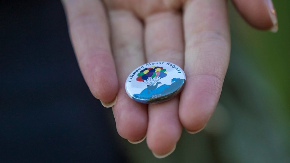 "Photo of an ""I climbed Mount Holyoke"" button"